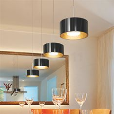 Show light fixtures to create zone lighting in the dining room